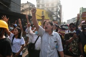 People shout slogans during a protest against the military coup in Yangon, Myanmar on February 26, 2021 [Reuters]