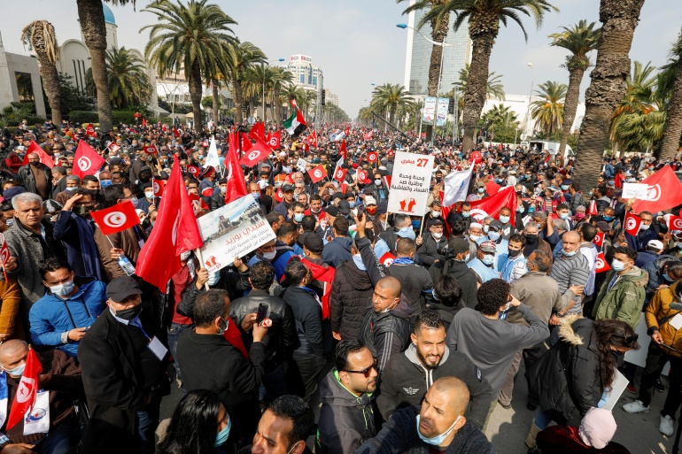Supporters of Tunisia's biggest political party march during a rally in opposition to President Kais Saied, in Tunis [Zoubeir Souissi/Reuters]