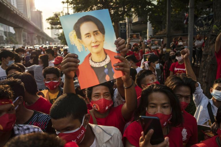 Adding to ongoing protests in Myanmar and overseas such as this demonstration in Bangkok, an activist group launched an online petition to end foreign investments in military-linked firms in Myanmar [File: Andre Malerba/Bloomberg]
