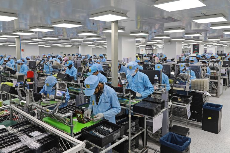 Dixon Technologies is on track to producing 50 million smartphones this year [File: Anindito Mukherjee/Bloomberg]