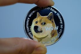 Dogecoin's surprising social media-fuelled rally is just one example of the revival in cryptocurrencies over the past year [File: Yuriko Nakao/Getty Images Europe via Bloomberg]