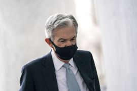 In a speech Wednesday, Chairman of the United States Federal Reserve Jerome Powell echoed the urgency voiced by President Biden for a robust $1.9 trillion in additional pandemic aid to help shore up the struggling US economy [File: Stefani Reynolds/Bloomberg]