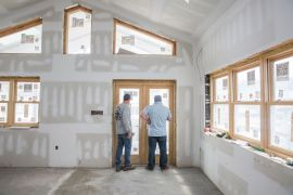 A measure of confidence among United States homebuilders improved slightly in February amid strong demand conditions, even as rising construction costs related to lumber prices threaten to slow demand, a report from the National Association of Home Builders showed [File: Bloomberg]