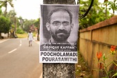 A poster at Kappan's village Poocholamadu in Kerala's Malappuram district, demanding his release [Shaheen Abdulla/Al Jazeera]
