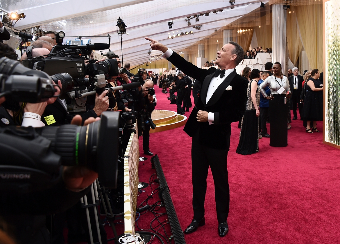 Hollywood Actor Tom Hanks arrives at the Oscars in Los Angeles on February 9, 2020. The star would later fall ill with the coronavirus. [Jordan Strauss/Invision/AP]