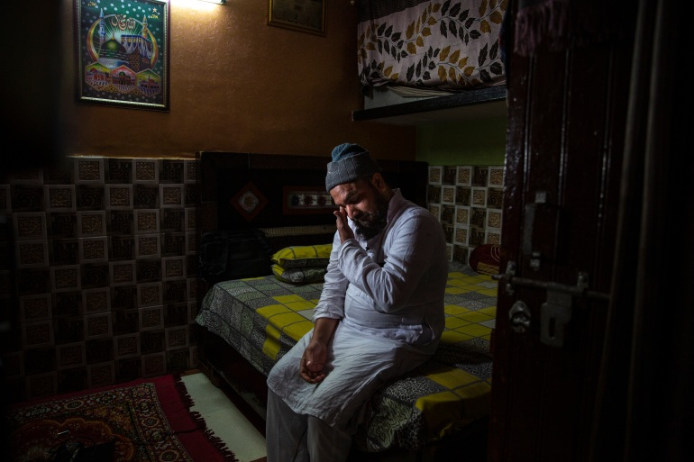 Haroon, who saw his 32-year-old brother being shot and killed by his Hindu neighbours during the February 2020 communal riots [Altaf Qadri/AP]