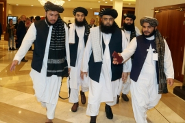 A few members of the Taliban delegation head to attend the opening session of the peace talks between the Afghan government and the Taliban in Doha on September 12, 2020 [File: AP/Hussein Sayed]