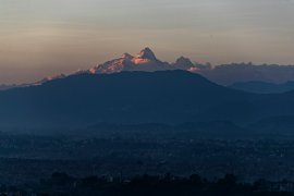 Himalchuli mountain, centre, and Manasulu mountain range, right, seen from Bhaktapur, Nepal [File: Niranjan Shrestha/AP]