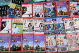 Newspapers and magazines reporting on Ethiopia's Tigray conflict seen at a news stand in Addis Ababa on November 7, 2020 [File: Samuel Habtab/AP Photo]