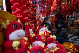 As families around the world welcome the Year of the Ox, traditional celebrations and travel have once again been hampered by the coronavirus pandemic [File: Ng Han Guan/AP Photo]