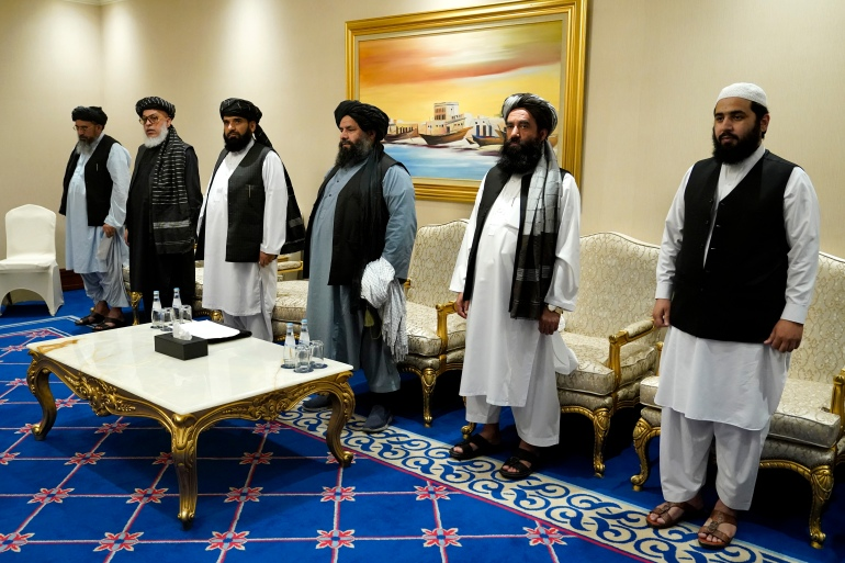 Members of the Taliban's peace negotiation team meet with US officials amid talks between the Taliban and the Afghan government, in Doha, Qatar on November 21, 2020 [File: AP/Patrick Semansky]