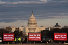 Billboard trucks parked on the National Mall near of the US Capitol during the impeachment trial of former President Donald Trump in Washington [Jose Luis Magana/AP Photo]