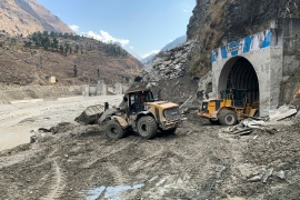Rescuers use machinery to remove muck and debris from a tunnel after a part of a Himalayan glacier broke off sending a devastating flood downriver in Tapovan area of the northern state of Uttarakhand [Rishabh R. Jain/AP Photo]