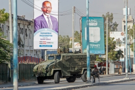Security forces block a street with an armoured personnel carrier during protests against the government and the delay of the country's election in the capital Mogadishu, Somalia, Feb 19, 2021. [AP Photo]