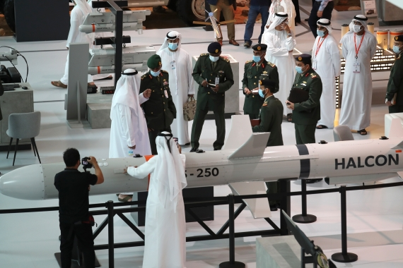 A delegation visits the display of Halcon, a manufacturer of precision-guided systems, during the opening day of the International Defence Exhibition & Conference, IDEX, in Abu Dhabi [Kamran Jebreili/AP Photo]