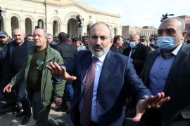 Armenian Prime Minister Nikol Pashinyan greets his supporters as he arrives at the main square in Yerevan, Armenia [Stepan Poghosyan/PHOTOLURE via AP]
