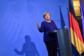 German Chancellor Angela Merkel addresses a news conference in Berlin. EU leaders are seeking to inject new energy into the bloc's lagging coronavirus vaccination effort [John MacDougall/Pool Photo via AP]