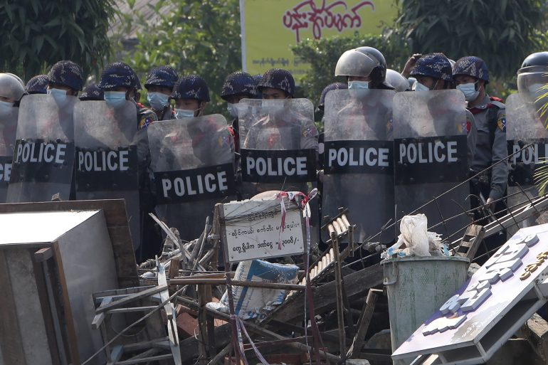 Myanmar riot police prepare to cross the blockades set up by protesters in Mandalay [AP Photo]