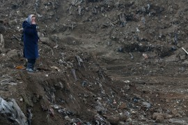 Nura Begovic, a Bosnian woman from Srebrenica, looks at a mass grave in the village of Kozluk, near the eastern town of Zvornik, Bosnia and Herzegovina [File: Amel Emric/AP Photo]