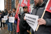 Uber drivers protest outside the Uber offices on May 8, 2019 in Birmingham, England [Photo by Christopher Furlong/Getty Images]