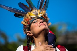 BOSTON, MA - OCTOBER 10: Chali'Naru Dones, with the United Confederation of Taino People, becomes emotional while standing on top of where the former Christopher Columbus statue had once been during a march in Boston on Oct. 10, 2020. The United American Indians of New England organized a demonstration on Saturday to continue the ongoing movement to change Columbus Day to Indigenous Peoples' Day and to demand the City remove the Columbus statue from Christopher Columbus Waterfront Park for good. (Photo by Erin Clark/The Boston Globe via Getty Images) (Getty Images)