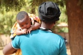 Pauline waits at an orphanage in Yako where she will leave her baby son [Sam Mednick/Al Jazeera]