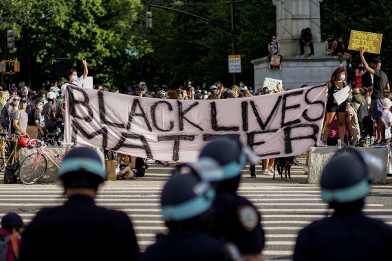Demonstrators hold a Black Lives Matter banner during a protest against racial inequality after the killing of George Floyd by a Minneapolis police officer, in front of the Grand Army Plaza in Brooklyn, New York in June 2020 [Eduardo Munoz/Reuters]