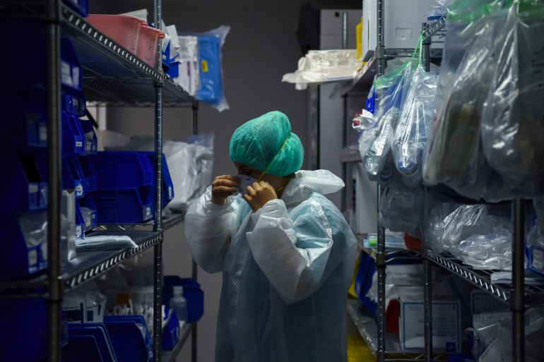 A medical worker puts on personal protective equipment at the United Memorial Medical Center's coronavirus intensive care unit in Houston, Texas, US [File: Callaghan O'Hare/Reuters]