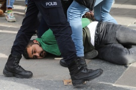 Plain-clothes police officers detain a demonstrator during a gathering in solidarity with Bogazici University students [Reuters]