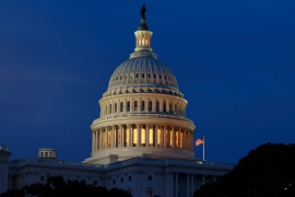 The United States Congressional Budget Office expects the budget deficit to fall to about $1 trillion in 2022 as the economy heals and there is less need for government spending [File: Carolyn Kaster/AP Photo]