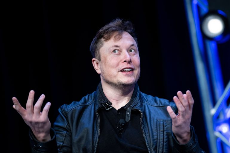 That Tesla, one of the world's most influential companies, and billionaire Elon Musk have thrown their weight behind Bitcoin is a massive sign of support for the cryptocurrency [File: BRENDAN SMIALOWSKI/AFP]
