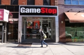 The GameStop surge was spurred by a final-hour rally on Wednesday that brought the video game retailer its biggest advance since January 29, the day Robinhood Markets restricted trading in it and 49 other stocks at the height of the market frenzy [File: Spencer Platt/Getty Images]