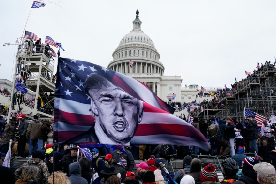 Pro-Trump protesters storm the grounds of the US Capitol, in Washington, DC on January 6, 2021 [File: Will Oliver/EPA-EFE]