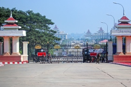 Military vehicles and soldiers guard the entrance to the parliament building in Naypyitaw, Myanmar [Maung Longlan/EPA]