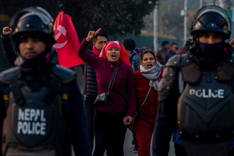 Nepal Communist Party supporters protesting during a general strike in Kathmandu on February 4, 2021 against the dissolution of Parliament [File: Narendra Shrestha/EPA]
