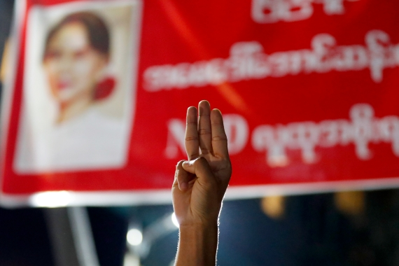 A man flashes a three fingered salute of defiance against the military coup in Myanmar. The US has urged the military to step down and free those it has detained including Aung San Suu Kyi [Nyein Chan Naing/EPA]