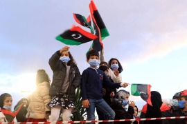 Children holding Libyan flags a day ahead of commemorations of the 10th anniversary of the uprising against former leader Muammar Gaddafi in Tripoli [EPA]