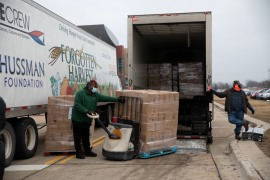 Volunteers unload trucks filled with boxes of food in Warren, Michigan, the United States, where the chair of the Federal Reserve told Congress on Tuesday that the path of the economy continues to depend significantly on the course of the coronavirus [File: Emily Elconin/Reuters]