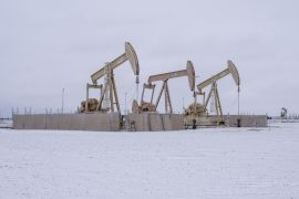 Pumpjacks operate in the snow in the Permian Basin in Midland, Texas, the United States, where weather has reduced the nation's refining capacity by one-fifth [File: Matthew Busch/Bloomberg]
