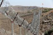 A view of the border fence outside the Kitton outpost on the border with Afghanistan in North Waziristan, Pakistan October 18, 2017 [Caren Firouz/Reuters]