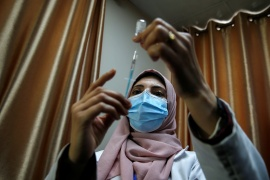 A Palestinian health worker prepares a coronavirus disease (COVID-19) vaccine in Gaza City February 22, 2021 (REUTERS/Mohammed Salem) (Reuters)