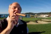 In this February 3, 2001 file photo, Rush Limbaugh puffs on his Ashton VSG cigar while participating in the AT&T Pebble Beach National Pro-Am golf tournament in Pebble Beach, California, US [AP Photo/Eric Risberg, File]