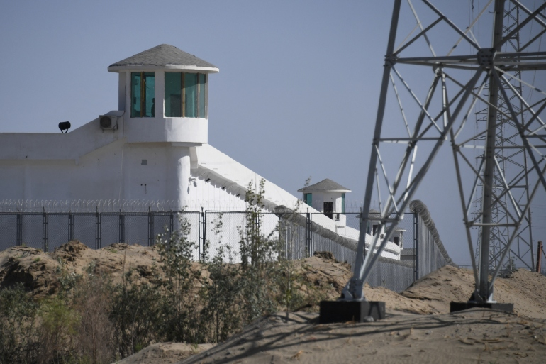 Watchtowers on a high-security facility near what is believed to be a re-education camp where mostly Muslim ethnic minorities are detained on the outskirts of Hotan in May 2019 [File: Greg Baker/ AFP]