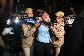 Police detain a woman during a protest outside the police headquarters in New Delhi on January 30, 2020 to demand action against a suspected Hindu nationalist who opened fire on demonstrators during a protest against a controversial citizenship law, outside Jamia Millia Islamia university [File: Prakash Singh/AFP]