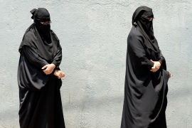 Women in burqas line up to take a blood sample for a COVID test in Colombo [File: Lakruwan Wanniarachchi/AFP]