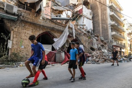 Children play on a street in the Gemmayzeh district of Lebanon's capital Beirut after the monster blast at the nearby port that devastated the city [File: AFP]