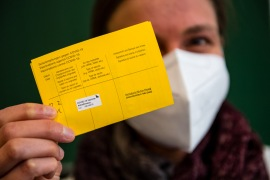 A vaccine passport can broadly be defined as a piece of documentation proving someone has been inoculated against a virus [File: Jens Schlueter/AFP]