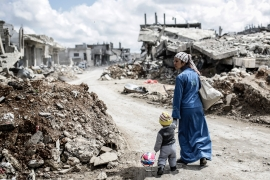 Nearly half a million people have been killed and more than half the pre-war population of 23 million displaced in the war [File: Yasin Akgul/AFP]