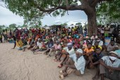 People displaced by the violence in Cabo Delgado gather for a community meeting in the Tara Tara district of Matuge, northern Mozambique on February 24, 2021 [AFP/Alfredo Zuniga]