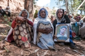People mourn the victims of a massacre allegedly perpetrated by Eritrean soldiers in the village of Dengolat, north of Mekelle [Eduardo Soteras/AFP]
